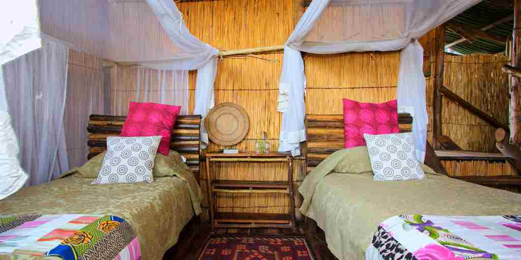 delta camp twin room beds botswana yellow zebra safaris
