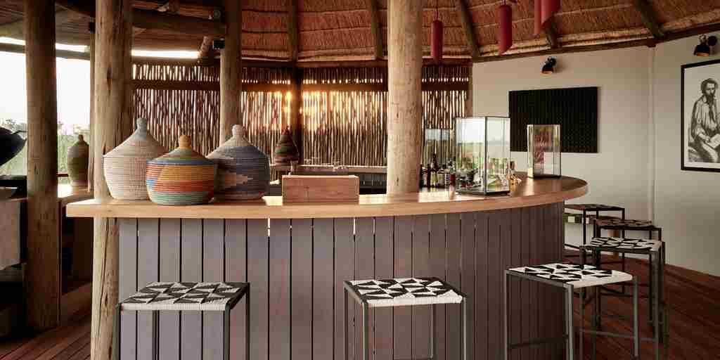 sanctuary baines camp bar area botswana yellow zebra safaris