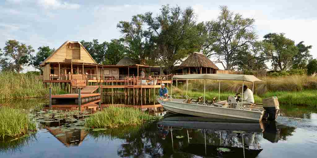 sanctuary baines camp exterior botswana yellow zebra safaris