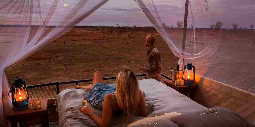 mwamba camp star bed sunrise zambia yellow zebra safaris