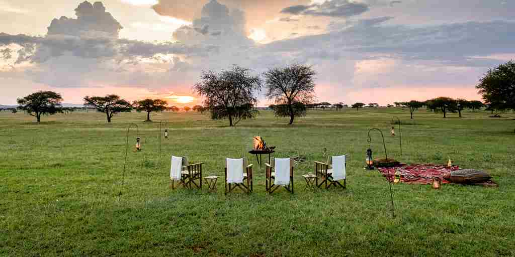 singita-sabora-tented-camp-camp-fire-tanzania-yellow-zebra-safaris.jpg