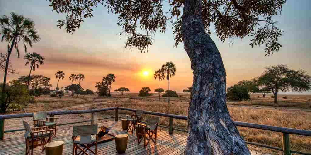 mbali mbali katavi camp fire sunset tanzania yellow zebra safaris
