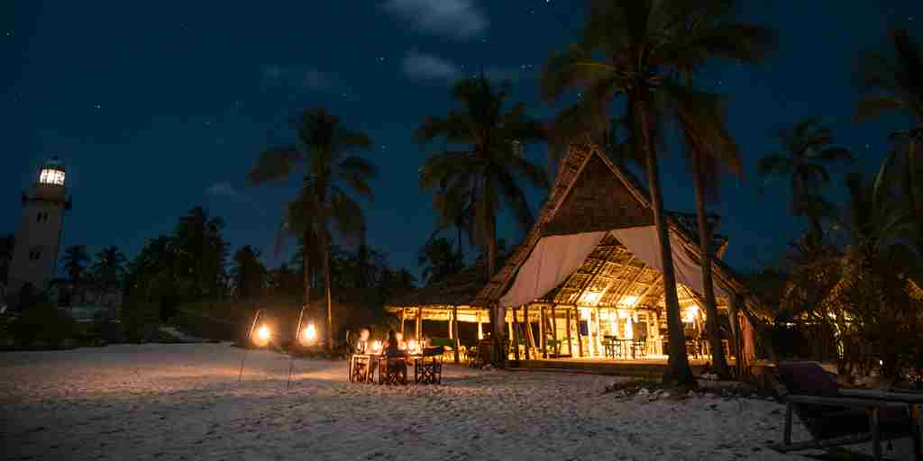 fanjove island night exterior tanzania yellow zebra safaris