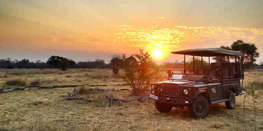 ntemwa busanga camp sunset zambia yellow zebra safaris