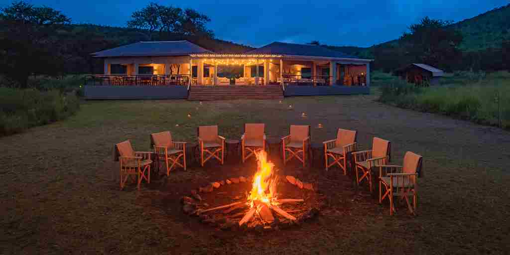 dunia camp fire night tanzania yellow zebra safaris