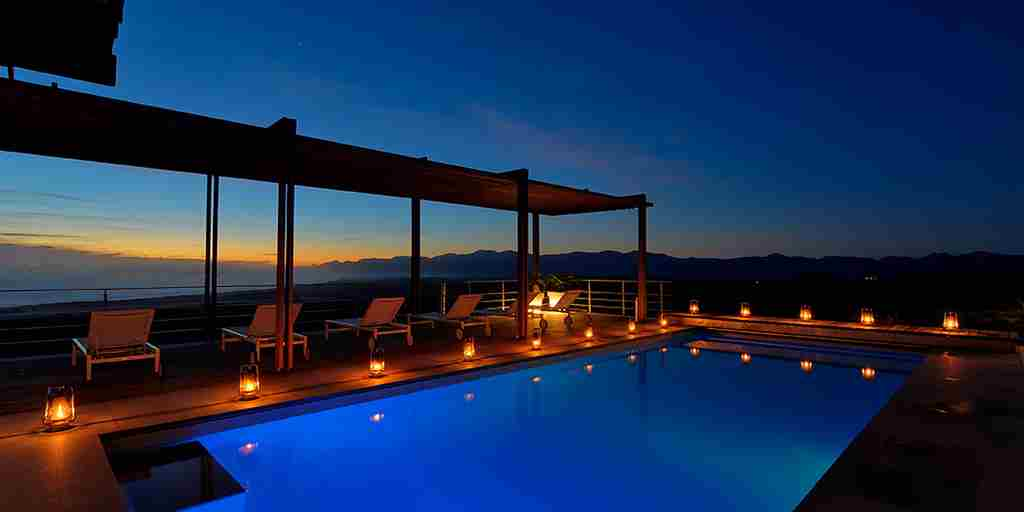 the-villa-pool-lit-up-at-night.jpg