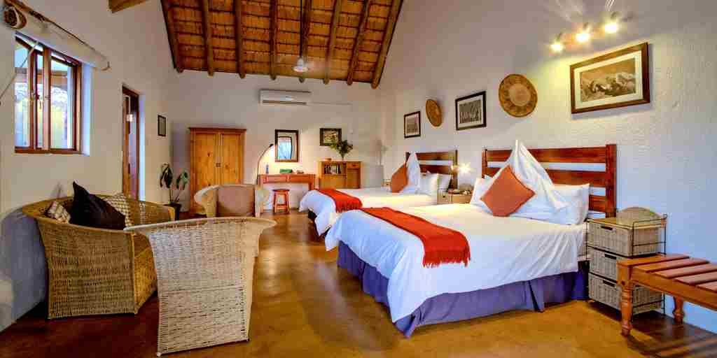 Thatched_Garden_Suite_Teak_Bedroom_Internal.jpg