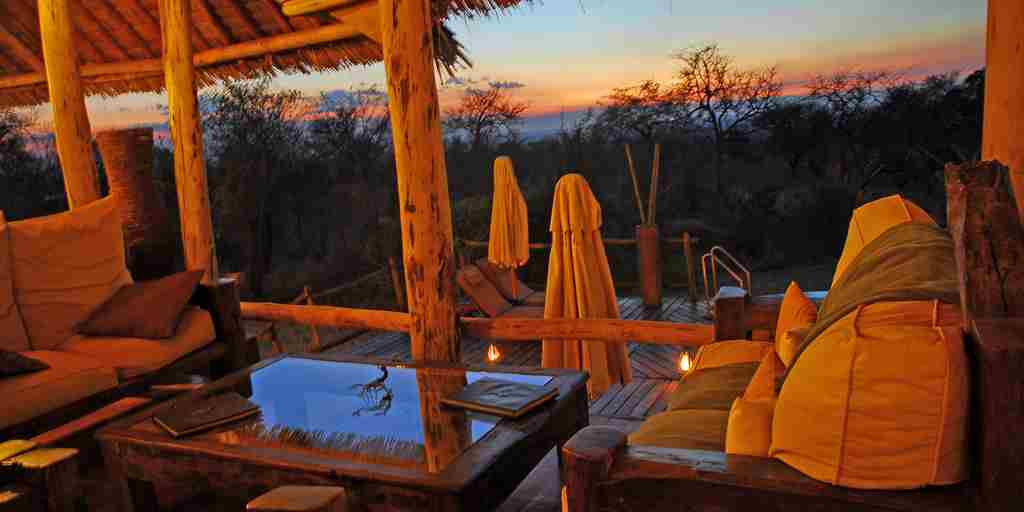 view from the main lodge across the swimming pool at sunset.jpg