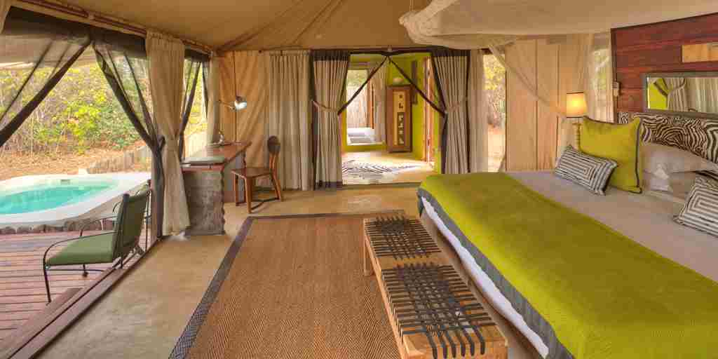 Azura Selous zebra tented villa with view to pool.jpg